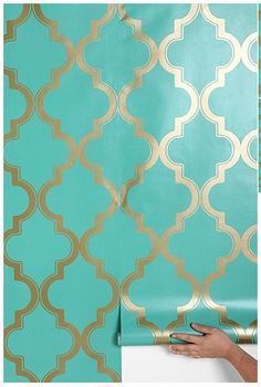 my favorites... turquoise and gold in a Marrakesh-inspired print... removable wallpapers via apartment therapy