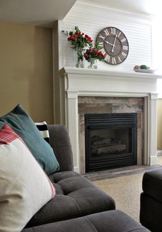 fireplace makeover with beadboard paneling and distressed wood tiles