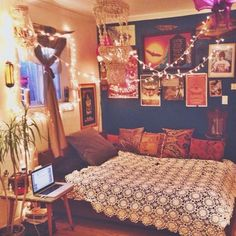 Bohemian bedroom. I love the quilt and the overhead lights!