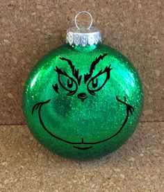 Everybody loves the Grinch! Well, maybe not everyone. But at least this Grinch wont steal your gifts! Ornament is glass and approximately 3 inches I love this idea! Vinyl Ornaments, Grinch Ornaments, Glitter Ornaments, Christmas Ornament Crafts, Holiday Crafts, Christmas Decorations, Ornament Tree, Handmade Ornaments, Ball Ornaments