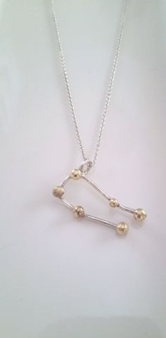Gemini is Latin for twins, and it is one of the few constellations that actually looks like its namesake. Gemini is one of the Zodiac constellations Gemini Star Constellation, Constellation Necklace, Handmade Necklaces, Handmade Gifts, Zodiac Constellations, Arrow Necklace, Twins, Brass, Jewellery
