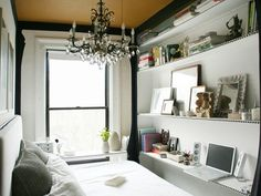 Undaunted by its tiny size and the fact that she is sharing this one-and-a-half bedroom apartment with a roommate, Spaces TV covers how art director and interior designer Jen Chu converted this teeny half-room into an eclectic chamber of her own, which doubles as a workspace, reading, sleeping and storage space, thanks to a few clever reconfigurations.