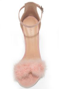 Be the trendsetter of the night in the Valentina Nude Feather Ankle Strap Heels! Faux suede shapes an adjustable ankle strap (with gold buckle) anchored by a slender heel cup, above a toe strap covered in fun, fluffy faux pinfeathers.