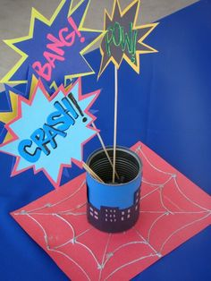 Super Hero Party table center pieces: Recycled tin cans, construction paper, puffy paint, and  skewers; is all u need:) #mycitymydreams