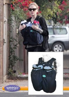 **EXCLUSIVE** New mom Anna Paquin keeps her fraternal twins close in a baby carrier, as she takes a stroll with her mother Mary Paquin in Lo...