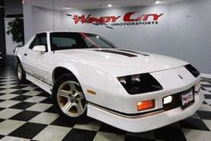 1985 - 1990 Chevrolet Camaro IROC-Z, styled similarly to the cars racing International Race of Champions.first two years was 305 V8, 350 became available in 1987. In 1988, IROC-Z became an actual trim, replacing the Z28. only way to get a manual transmission was to put a check mark for the 305 engine. Power ranged from an asthmatic 155 horsepower base engine or 5.7-liter with 230 hp. the IROC-Z could go from 0 - 60 in 6.9 seconds. rare treat is to find an IROC-Z convertible