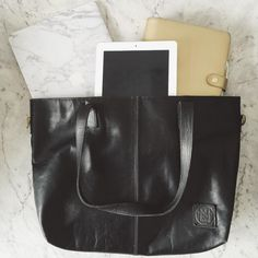 Black leather tote bag by @mahileather