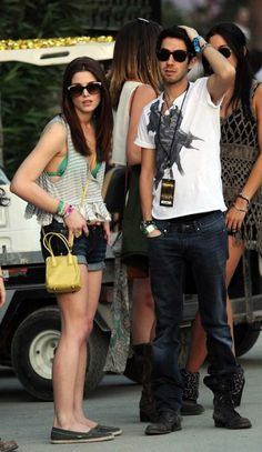 Ashley Greene and her new boyfriend Kings of Leon member, Jared Followill hang out with some friends on  Day 1 of the Coachella Music Festival in Indio, California.