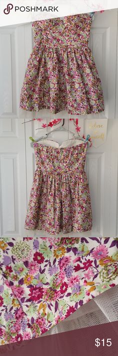 NWOT Sans Souci strapless floral dress. Size L Your style will be in full bloom in this Lovely Strapless Floral Dress with small Petticoat under the Skirt! The hourglass shape of the dress combined with the invisible Back zipper & elastic around the top ensures a snug fit. So  cute!! 100% cotton with a satin like lining for extra comfort! Built in belt loops allow you to pick your favorite belt to complete your perfect look!  This dress is NEW, never worn Chest 32in Length 25in    Ships…
