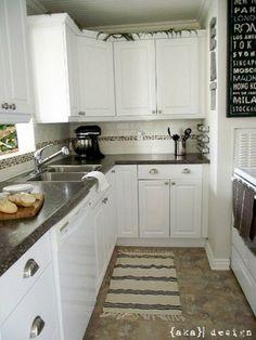 white cabinets, dark countertops