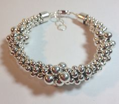 Graduated Silver Ball Kumihimo Bracelet by KristaBellerDesigns, $60.00