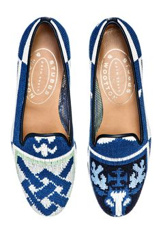 "These particular needlepoint slippers are individual, and not always identical to the represented. Based on the weaver's discretion each pair is special, and seldom repeated, based on different crests and subtle changes in coloration.  Our Classic Crest slipper features a Patterned Needlepoint Upper with a Navy Leather Trim.   Meticulously Hand-crafted in Spain. Leather lined to provide additional support and comfort. The stacked wooden heel is ¾"" in height. Leather soled.True to American…"