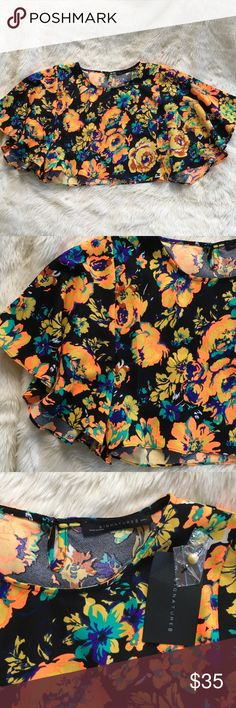 Neon floral crop top I can't even with this top right now!!! This is the most stunning and eye catching crop top.  Large flows sleeves and cute button and keyhole in the back.  New with tags.  Unfortunately this top is too small for me, nor could I do it any justice so I cannot model and I could not find any pics online for it so please let me know if I can get any measurements for you! Signature 8 Tops Crop Tops