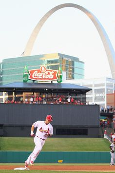 David Freese after hitting a home run - love The Arch in the background. Awww yeahhhh.