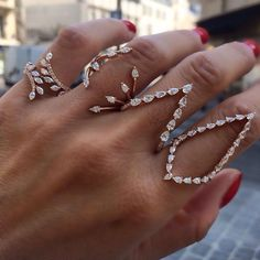 I love completely impractical jewelry!  Can't comb your hair or refresh your lipstick but damn these rings are gorgeous!
