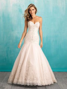 Style 9325 A baroque waistline and elegant embroidery add an element of vintage appeal to this gown.