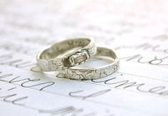 Simple engagement ring and wedding band.