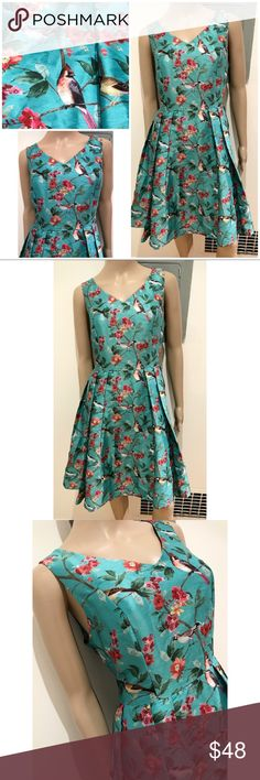 """eShakti Birds Floral Leaves Crepe Pleated DRESS In excellent pre-loved condition semi Pleated sleeveless dress from eShakti in size medium / 10. Hidden back zipper with pockets and liner. No flaws. Color is almost greenish Turquoise. Gorgeous birds and Floral details. Measure about 36"""" lenght, 17"""" bust, 15"""" waist, 22"""" from waist to bottom. Soft v neck. Last photo of model is the same style but with sleeves. ❌No trades or modeling. Always open to reasonable offers. Bundle more items for…"""