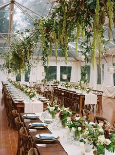 charlotte jenks lewis; potomac; maryland; Pineapple Productions; tented reception; clear tent; reception in tent; overhead greenery; bare feasting tables; wooden chairs; white table runners; white and green floral;
