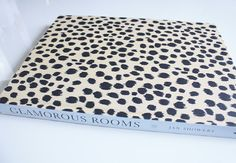 """Leopard skin cover under the dust jacket. Yummy! """"Glamourous Rooms"""" by Jan Showers"""