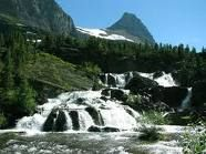 Glacier National Park.  Forget the resorts, go to see majesty in nature.