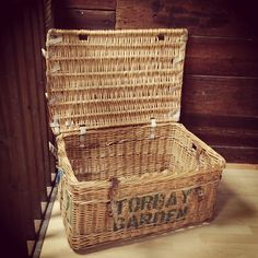 Used on trains to transport commercial goods this industrial sized basket has a multitude of uses. It is very strong and hard wearing. This particular basket is full of local history and displays Torbay Garden on the front. It can be belted up with its real leather straps.