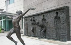 """""""Freedom"""" is a public sculpture created by Philadelphia-based artist, Zeno Frudakis, who wanted to create something that regardless to background, everyone could relate to the idea of struggling to break through."""