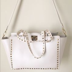 """BCBG stud tote with clasp close BRAND NEW WITH TAG Brand new BCBG stud tote bag . In stone color.15""""x9.5""""x5.5"""" BCBG Bags Totes"""