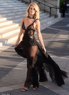 Rosie Huntington-Whiteley was a vision in a lingerie-effect black dress as she arrived at the Atelier Versace show during Paris Fashion Week Haute Couture Fall/Winter 2015/2016 on Sunda  Read more: http://www.dailymail.co.uk/tvshowbiz/article-3150285/Rosie-Huntington-Whiteley-leaves-little-imagination-goes-braless-sheer-lingerie-style-dress-Versace-Haute-Couture-Paris-show.html#ixzz3f8CISij5