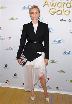 Diane Kruger always keeps up with the latest trends! Like she did in this black Theory blazer paired with a sheer white skirt and white pumps.