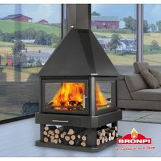 Bronpi Huelva Stove - 4 sided fireplace is a high heat output contemporary wood burning stove. Bronpi Huelva is ideal for heating large open plan spaces and you can enjoy the views from the wood burning flames at all angles. The Bronpi Huelva features also a log store for useful storage and an airwash facility for clean glass. Bronpi Huelva Stove features 200mm flue outlet 538 x 310 x 600mm chamber airwash 16kw heat output