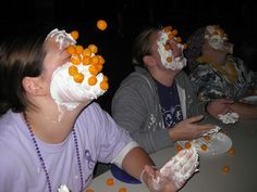 Cheese ball toss..just...omg. I have an idea, let's spread frosting on our faces and see how many cheese balls can stick! ...I would so do this