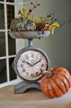 Fall display in a scale clock from Antique Farmhouse   www.andersonandgrant.com