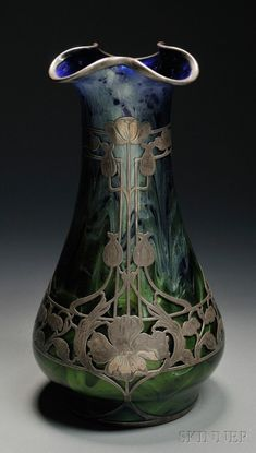 Loetz Titania Silver Overlay Vase Art glass and sterling silver Austria, c. 1906 Ruffled rim on blue and green glass with a floral Art Nouveau metal overlay design, polished pontil, unmarked, ht. Décor Antique, Antique Glass, Cristal Art, Bijoux Art Nouveau, Art Of Glass, Crushed Glass, Vase Shapes, Glass Ceramic, Objet D'art