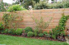 Shelley Hugh-Jones Garden Design: Western red cedar batten fencing acts as a bac...
