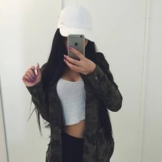 Camo jacket + white crop tank top + high waisted black jeans + white cap