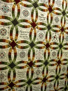 Wedding Ring Quilt | Flickr - Photo Sharing!  This is a wedding ring quilt with the names and wedding date of the couple it was made for embroidered in a square in the middle. There were other motifs in the centers of the rings, as well as various embroidered quotes about love.