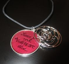 Roses are red, violets are blue... A 2 pc rose accent pendant on a 16-inch black leather choker with a heart toggle clasp.   The words Roses are Red, Violets are Blue... are written on the bottom part of the pendant and you can see them when you slide the top part of the pendant (with the silver filled rose) to the side.   Perfect for Valentine's Day, or any day you want to say I Love You.   http://www.newlyfoundtreasures.etsy.com