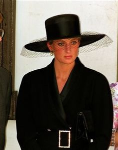 I remember seeing this look on Diana's face so many times.  Usually later it would come out that she was being treated bad by Charles and his family.  I always thought they were/are so cruel.
