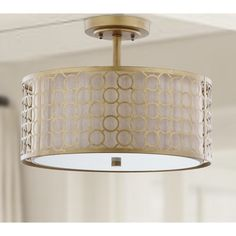 A distinctive marriage of a cream fabric shade with geometric-patterned laser cut steel in antique gold finish, the Giotta ceiling light showcases the glamorous drum shade-within-a-shade trend. Giotta is ideal for a transitional kitchen, bedroom, or hall. Gold Ceiling Light, Ceiling Lamp Shades, Ceiling Light Fixtures, Ceiling Lights, Flush Mount Lighting, Home Lighting, Hallway Lighting, Laser Cut Steel, Shops