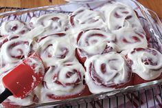 Frosted Red Velvet Rolls in pan
