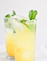 Coconut Mango Mojitos Coconut rum, mango purée, club soda, mint, lime and mint simple syrup.