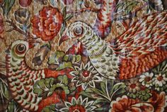 """Circa 1810-1820 Chintz whole cloth quilt, printed game bird/palm tree design is on a roller ground in tea or vermiculite ground. Olive green and tan with mahogany color. Bound with green/brown plaid cotton; back with later cylinder dress print, small repeat print in browns.98"""" x 81"""" Ebay $2,160.00"""