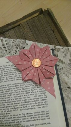 Flower Bookmark. I found the tutorial on Pinterest and this is what I came up with!  I really like it! Just wish I could have found my brads.  http://craftingupastorm.blogspot.co.uk/2013/04/origami-bookmark.html?m=1