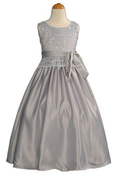 Classy Sparkling #Silver #Lace Flower Girl #Dress: This classy silver lace flower girl dress needs no introduction. This simple yet elegant A-line dress features a sleeveless cut, a lace bodice with satin skirt and a fully removable sash. The sparkling glittery lace bodice will shine from miles away at any special event. Make your little girl feel like a princess today in this silver flower girl dress.
