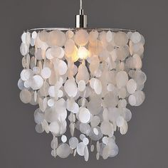 Small Round Capiz Pendant by West Elm     From sea to ceiling. Tiers of luminous natural capiz shells are cut and strung by hand to form this Small Round Capiz Pendant, which softly diffuses light, casting a romantic glow.   $129.00