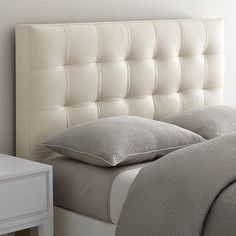 love this leather tufted headboard from WestElm - really elegant mixed with the narrow leg bed frame.