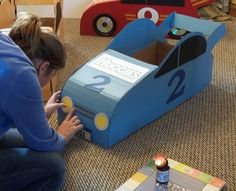 My grandson, Caden is turning 2 this Saturday.  He's really into cars, so my daughter decided to make some race cars from boxes she saw on Pinterest for his car themed birthday party. She got seve...