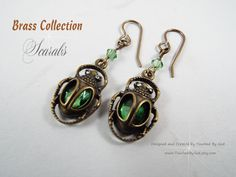 Jewelry Earrings, Scarab Beetles with Green Glass Stones, Swarovski Crystal accents and natural brass earwires ~ Ancient Egyptians often wore amulets or charms to protect themselves from malevolent forces. People wore these charms from infancy through death. During life, Egyptians carried the Scarab amulet to protect their hearts and give them long lives. Visit my Etsy shop @ www.TouchedByGod.etsy.com!