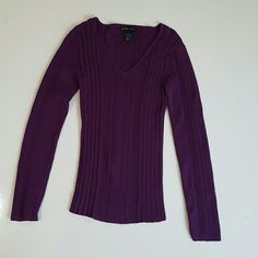 Purple sweater Adorable v neck New York and company ribbed purple swearter. Wonderful and soft made with acrylic and nylon. In used condition, has some piling but looks great. New York & Company Sweaters V-Necks
